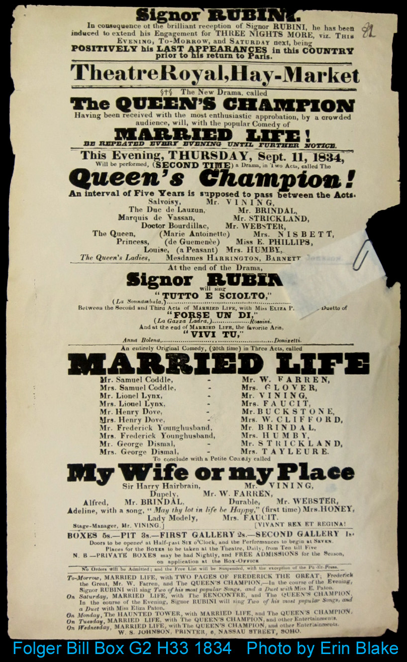 Playbill with folded slip of paper folded over one side and held by a paperclip