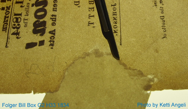 Tip of a scalpel shown scraping away excess in-filling paper along the seam