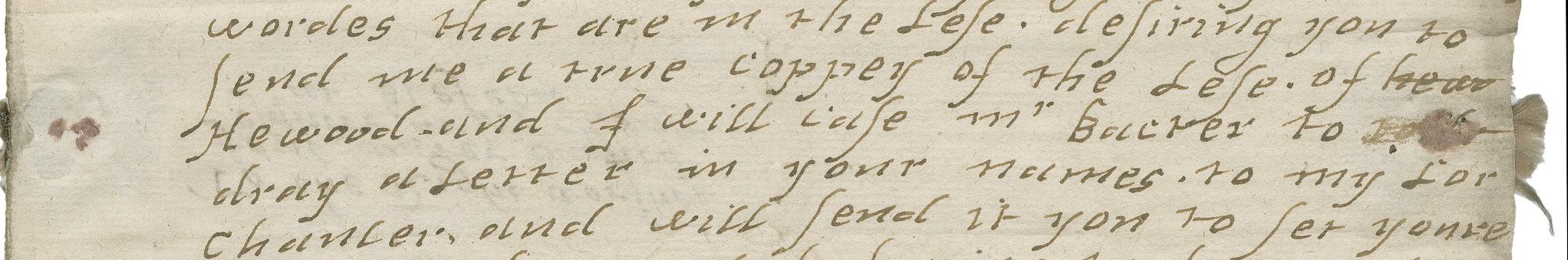 Detail of silk floss threaded through a letter to make it tamper-proof. Folger MS L.a.19. Click image to view entire letter in Folger digital image database.