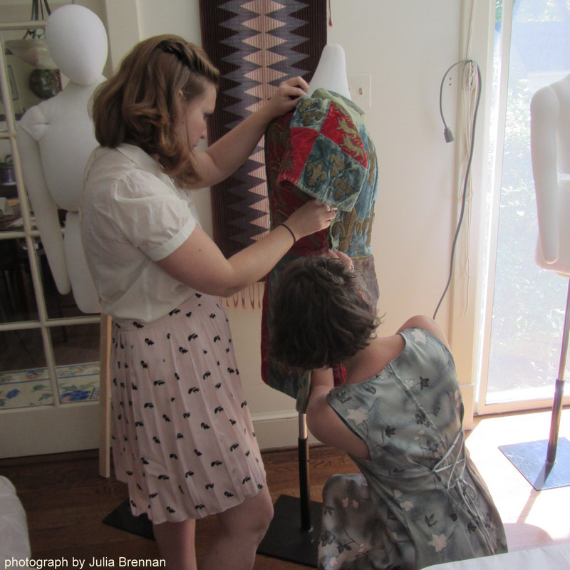 Jane Schwartz and Lorenza Lattanzi make adjustments for Edwin Booth's Richard III costume.