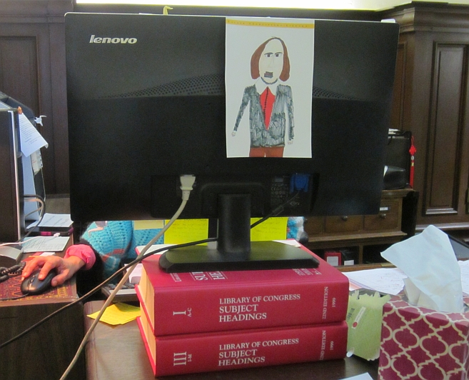 Big books used as a monitor stand