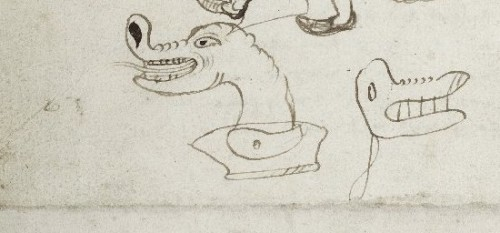 detailed view of two of the monster heads