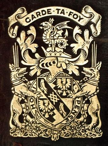Heraldic crest of Magdalene College, Cambridge, surmounted by a wyvern.