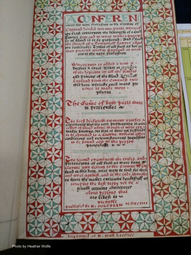 Manuscript page, primarily in red and green ink