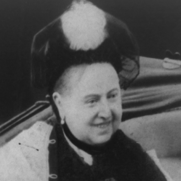 Head and shoulders photo showing Queen Victoria's toothy smile