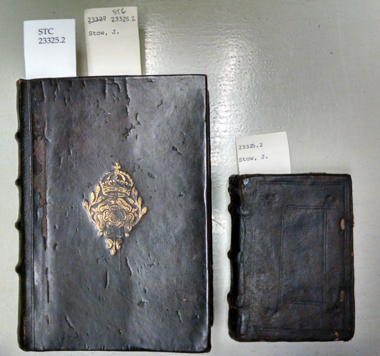Two leather-bound books, one much larger than the other.