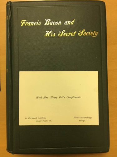 "Black bound book with inlaid gold title ""Francis Bacon and His Secret Society"" with compliments card of Constance Pott is laid in."