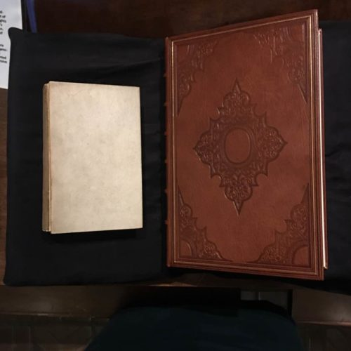 quarto-sized book next to a reproduction sized book