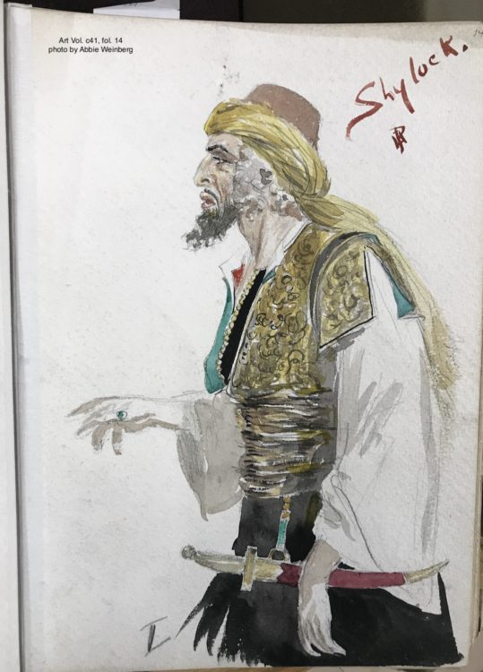 costume design for Shylock, wearing a white shirt with an embroidered gold vest, holding a long knife in a red sheath.
