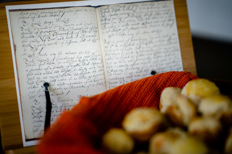 Facsimile of biscuit recipe with baked biscuits in foreground